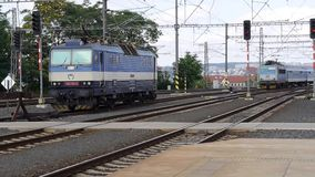 InterCity Express train pulling in to Prague station. Old model train stock footage