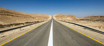 Intercity road in desert of the Negev Royalty Free Stock Images