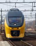 Intercity train arriving at the station of Gouda Stock Images