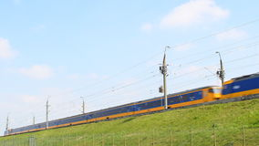 Intercity train of the Dutch Railways NS- Nederlandse Spoorwegen passing stock video footage