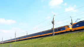 Intercity train of the Dutch Railways NS- Nederlandse Spoorwegen passing stock video