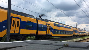Intercity train of the Dutch Railways NS- Nederlandse Spoorwegen passing stock footage