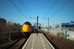 Intercity train ICM Koploper along the platform of railway station Voorburg in the Netherlands. Intercity train ICM Koploper along the platform of railway stock image