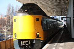 Intercity train ICM Koploper along the platform of railway station Voorburg in the Netherlands. Intercity train ICM Koploper along the platform of railway stock photo