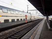Intercity train at a local station in Switzerland Royalty Free Stock Photo