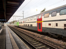 Intercity train at a local station in Switzerland Royalty Free Stock Images