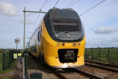 Intercity train at railroad track between Gouda and Rotterdam at Moordrecht.  royalty free stock photography