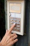 Intercom with hand of woman on keypad Stock Photos