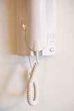 Intercom in home. Intercom indoor white on a white wall for door opening detail Royalty Free Stock Photography