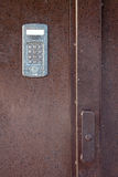 Intercom in steel door Royalty Free Stock Image