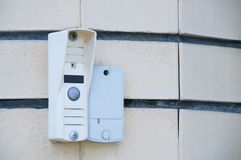 Intercom on the wall of the house. stock images
