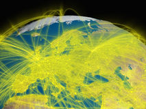 Interconnected Europe. Illustration of Europe from space with glowing yellow connections between cities and continents representing global airline networks Stock Image