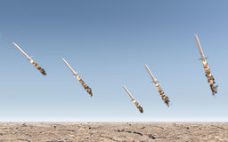 Intercontinental Ballistic Missile. A row of intercontinental ballistic missiles launching in a desert on a blue sky backgrund - 3D render Stock Photo