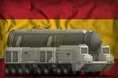 Intercontinental ballistic missile on the Spain national flag background. 3d Illustration. Intercontinental ballistic missile on the Spain flag background. 3d Stock Image