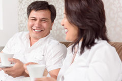 Intercultural family drinking coffee Stock Photo
