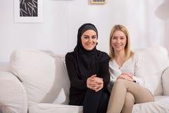 Intercultural friendship between women Stock Photo