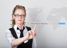 Intercultural learning written in search bar on virtual screen. Internet technologies in business and home. woman in. Intercultural learning written in search Royalty Free Stock Image