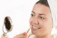 Interdental Brush. Young woman using an interdental brush Stock Photo