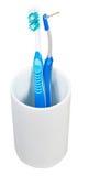 Interdental en och tandborstar i keramiskt exponeringsglas Arkivbild
