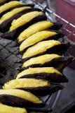 Intere banane al forno Fotografia Stock