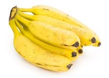 Intere banane isolate su bianco Fotografia Stock
