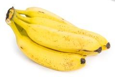 Intere banane isolate su bianco Fotografia Stock Libera da Diritti