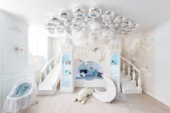Interer of a spacious blue children`s room. decorative castle game Royalty Free Stock Photo