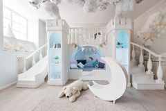 Interer of a spacious blue children`s room. decorative castle game Stock Photos