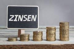 Intereses de Zinsen en alemán Imagenes de archivo