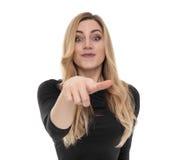 Interessiertes blondes zeigt etwas an Stockfotografie