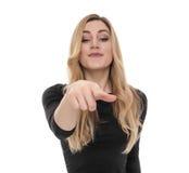Interessiertes blondes zeigt etwas an Lizenzfreies Stockfoto