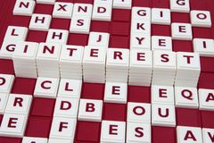 Interest in letters. A word game spelling out the word interest among many letters Stock Photo