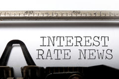 Interest rate news. Interest rates headline printed on an old typewriter Royalty Free Stock Image