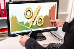 Interest rates concept on a computer monitor. Businesswoman showing interest rates concept on a computer screen Stock Image