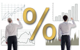 Interest rates concept drawn by businessmen. Interest rates concept drawn on a white wall by businessmen Stock Photo