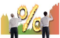 Interest rates concept drawn by businessmen Royalty Free Stock Photography