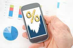 Interest rates concept on a smartphone. Held by a hand Stock Photography
