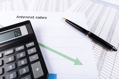 Interest rates. Documents with calculator Royalty Free Stock Photography