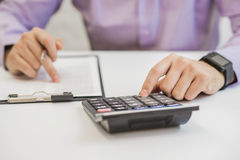 Interest rates documents with calculator.  Stock Photo