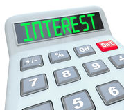 Interest Word Calculator Figure Growth Rate Loan Cost. A plastic calculator displays the word Interest as you figure how the percentage interest rate you will Royalty Free Stock Images