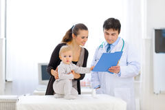 Interested baby on examination of pediatric doctor Royalty Free Stock Images