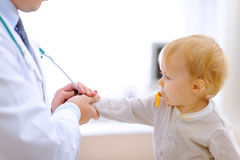 Interested baby stretching for stethoscope Stock Photography