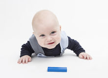Interested baby with toy block Stock Photography