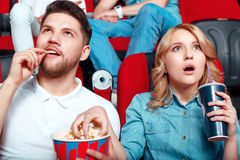 Interested couple in cinema Stock Images
