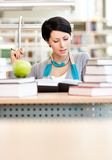Interested female student studies at the desk Stock Photography