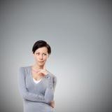 Interested gaze. Isolated on grey Royalty Free Stock Photography