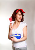 Interested girl with lollipop and popcorn watching  on a Stock Photo