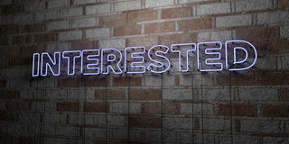 INTERESTED - Glowing Neon Sign on stonework wall - 3D rendered royalty free stock illustration Stock Photos