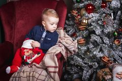 Interested little boy holding a christmas stocking royalty free stock photos