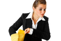 Interested modern business woman checking parcel Royalty Free Stock Photos